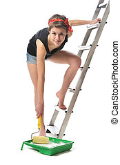 home improvements - young girl with paint roller standing on...