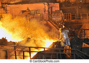 A steel worker inside of plant