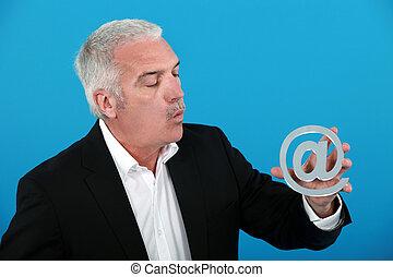 Man holding an @ sign