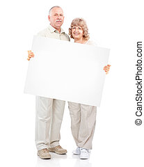 Senior happy couple with placard.
