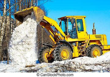 Wheel loader unloading snow - Construction and snow removal...