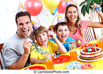 Happy Birthday. Father, mother and children celebrating...