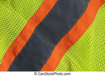 Safety Vest Background - close up of a construction worker's...