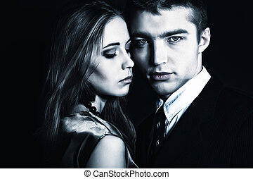 love sense - Portrait of a beautiful young couple embracing...