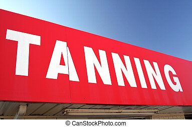Tanning Sign on Convenience Store