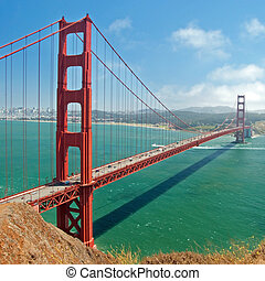 The Golden Gate Bridge in San Francisco with beautiful azure ocean in background