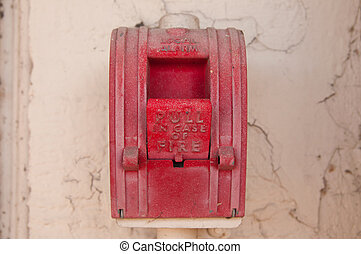 Vintage red wall fire alarm on stucco wall - A Vintage red...