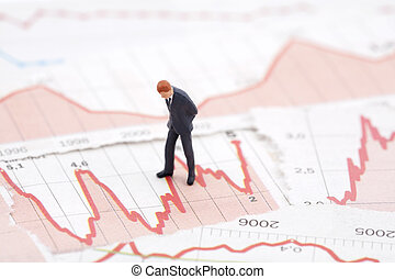 Financial crisis - Figure of businessman on financial charts