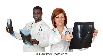 Two doctors with radiography a over white background
