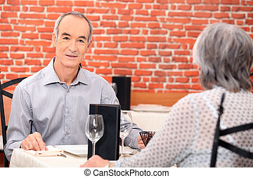 Senior couple eating a meal in a restaurant