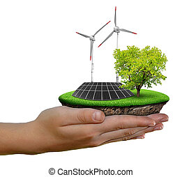 Little island in hands - Little island with solar panel and...