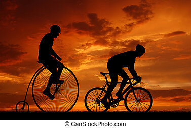 silhouette cyclists on bicycles