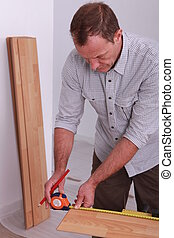 cabinetmaker taking measurements