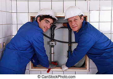 two plumbers resting after work