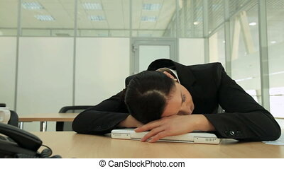 Sleeping businesswoman - Dolly shot of a pretty...