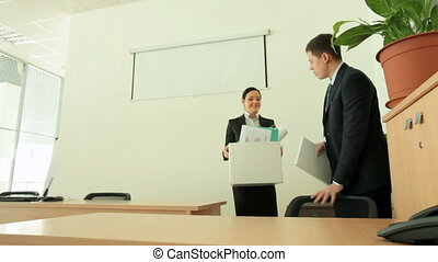 New workplace - Boss showing his new employee her place of...