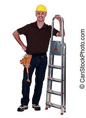 feliz, manual, trabajador, se paró, paso, escalera