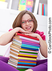 School girl with lots of books