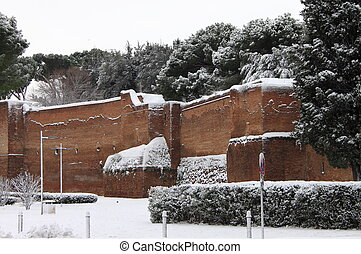 Surrounding walls of Rome under snow in wintertime