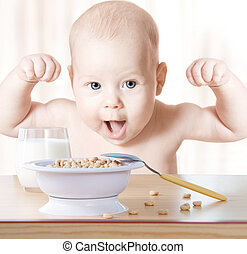 Happy baby meal: cereal and milk Concept: healthy food makes...