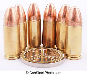peace sign - A peace sign with 9mm cartridges