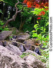 waterfall in garden - beautiful scenic waterfall in garden