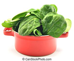 Spinach in a red cauldron - Spinach leaves stacked side by...