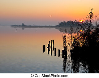 Reflecting sunset over lakeside
