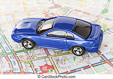 blue car on Dublin city map - tourism concept small blue car...