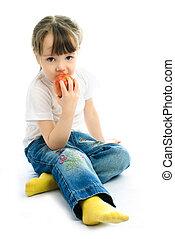 little girl eating an apple - adorable little girl sitting...