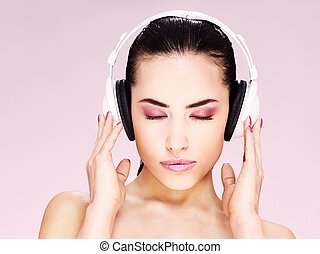 woman with headphones - Pretty woman with headphones...