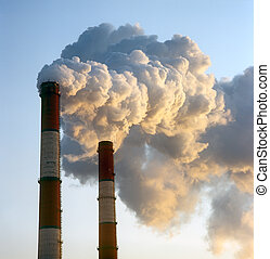 Smokestacks. - Air pollution by smoke coming out of two...