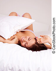 girl waking up - pretty brunette girl waking up and...