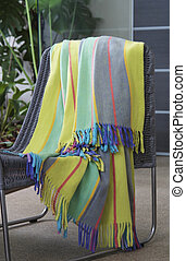 Colourful throw draped over a chair