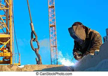 Welder at work - Builder worker welder during installation...