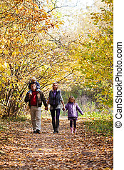 Family Enjoying Walk In Park