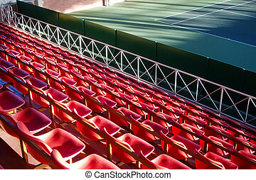 Tribune - Empty tribune with red seats over tennis court