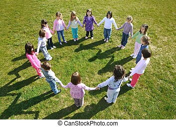 preschool kids outdoor have fun - happy child kids group...