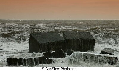 Storm Waves Smashing Against Breakwaters. High Contrast