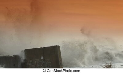 Stormy Beach - Storm Waves Smashing Against Breakwaters.