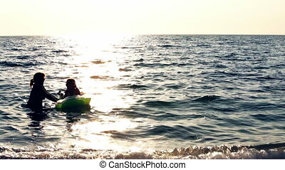 Swimming HD - Woman with child are swimming in a sea.