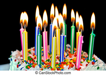candles on a birthday cake - Many colorful candles on a...