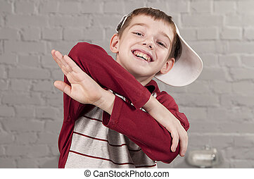 hip-hop dancer - Portrait of boy 10 years with crossed arms...