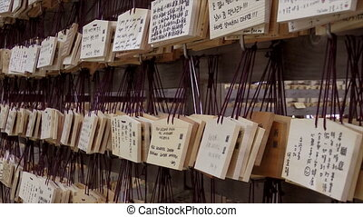 Prayer tiles, Meiji Jungu Shrine. Prayers are written on a...