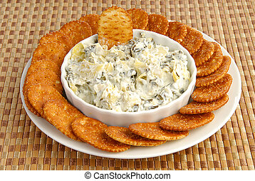 Crackers nad artichoke spinach dip - A plate of crackers...