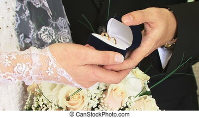 Engagement ring HD - Groom wears an engagement ring on bride...