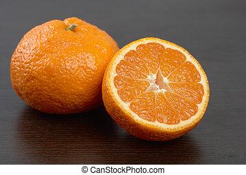 mandarins on dark background