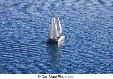 Catamaran sailing over Kyrg lake - Catamaran sailing over...