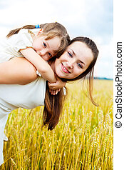 happy mother and daughter - beautiful young mother and her...