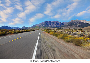 A trip at high speed   to the distant mountains